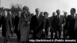 FILE - In this Jan. 16, 1979 file picture, Shah Mohammad Reza Pahlavi and Empress Farah walk on the tarmac at Mehrabad Airport in Tehran to board a plane to leave Iran.