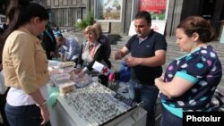 Armenia - Syrian Armenians sell their handmade products at a fair in Yerevan, 20May2014.