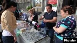 Armenia - Syrian Armenians sell their handmade products at a fair in Yerevan, 20May2014.