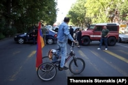 Supporters of opposition lawmaker Nikol Pashinian block a street in central Yerevan on May 2.