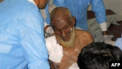 Medical staff treat a victim following twin bomb attacks in northwestern Pakistan.
