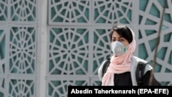 An Iranian woman wearing a face mask in Tehran on March 2