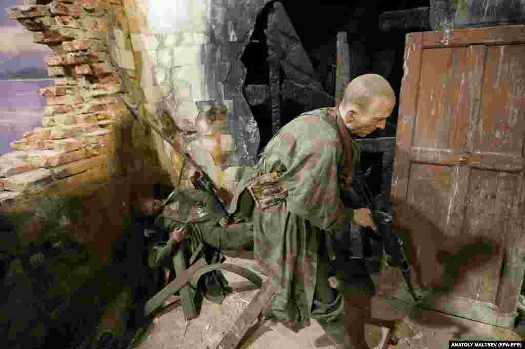 "A scene from the street battles of Stalingrad. Russia's representation of the Second World War was criticized in September after a Kremlin-funded exhibition: 75 Years Of The Liberation Of Eastern Europe From Nazism, was held in Bulgaria's capital, Sofia. The Bulgarian Foreign Ministry said in a statement: ""Without ignoring the contribution of the U.S.S.R. to the defeat of Nazism in Europe, we cannot turn a blind eye to the fact that the bayonets of the Soviet Army brought the people of Eastern Europe half a century of repression."""