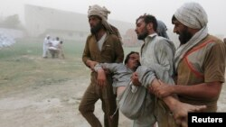 Since 2003, more than 50,000 civilians, militants, and soldiers have died in attacks by militants and Pakistani military sweeps across FATA. The fighting also displaced more than 3 million civilians. Men carry a displaced resident of North Waziristan, in Bannu, Khyber Pakhtunkhwa in June 2014. He fainted while queuing up for food supplies (file photo).
