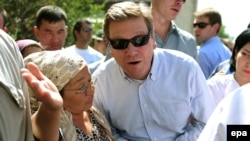 German Foreign Minister Guido Westerwelle visits a neighbourhood hit by ethnic unrest in Osh on July 16.