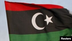 Libya -- Fighters with Libya's interim government celebrate in the centre of Bani Walid, 17Oct2011