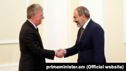Acting Armenian Prime Minister Nikol Pashinian (right) meets U.S. national-security adviser John Bolton in Yerevan on October 25.