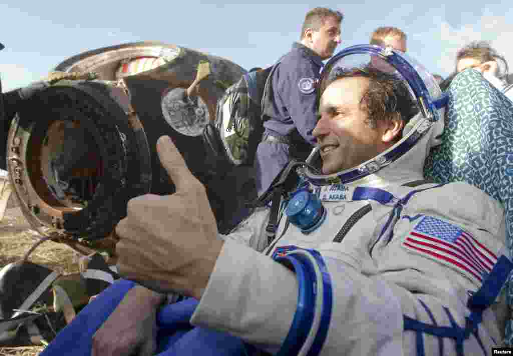 Acaba gives the thumbs-up shortly after being removed from the capsule.