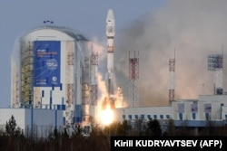A Soyuz rocket carrying a Russian meteorological satellite lifts off at the Vostochny Cosmodrome outside the city of Uglegorsk in Russia's Far East.