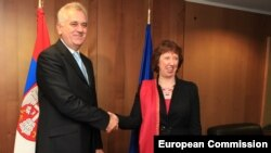 Catherine Ashton (left) and Tomislav Nikolic finally meet on June 14 -- all's well that ends well.