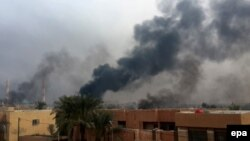عکس مربوط به درگیری ها در شهر فلوجه عراق است.