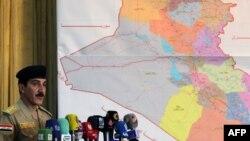 Ирак премьер-министрінің қауіпсіздік мәселелері жөніндегі өкілі генерал-лейтенант Кассем Атта баспасөз мәслихатында сөйлеп тұр. Бағдад, 28 маусым 2014 жыл.
