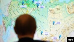 Russia -- Russian President Vladimir Putin looks at Russian map during a live-broadcasted test-launch of the Russia's Angara-A5 new heavy-class rocket from the Plesetsk cosmodrome in the Arkhangelsk region, December 23, 2014
