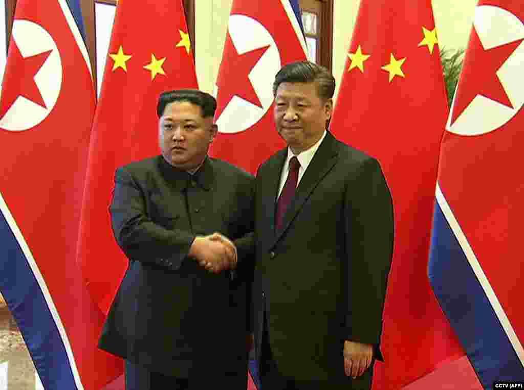 Ким Чен Ын мен Си Цзиньпин.