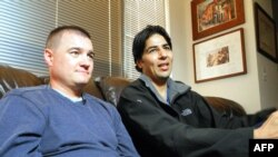 U.S. Army Captain Matt Zeller (left) sits with translator Janis Shenwari, whom he credits for saving his life in a firefight in Afghanistan in November 2008, during an interview in November 2013 in Arlington, Virginia.