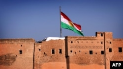 The Kurdish flag flying over the Irbil Citadel, in the capital of the autonomous Kurdish region of northern Iraq.