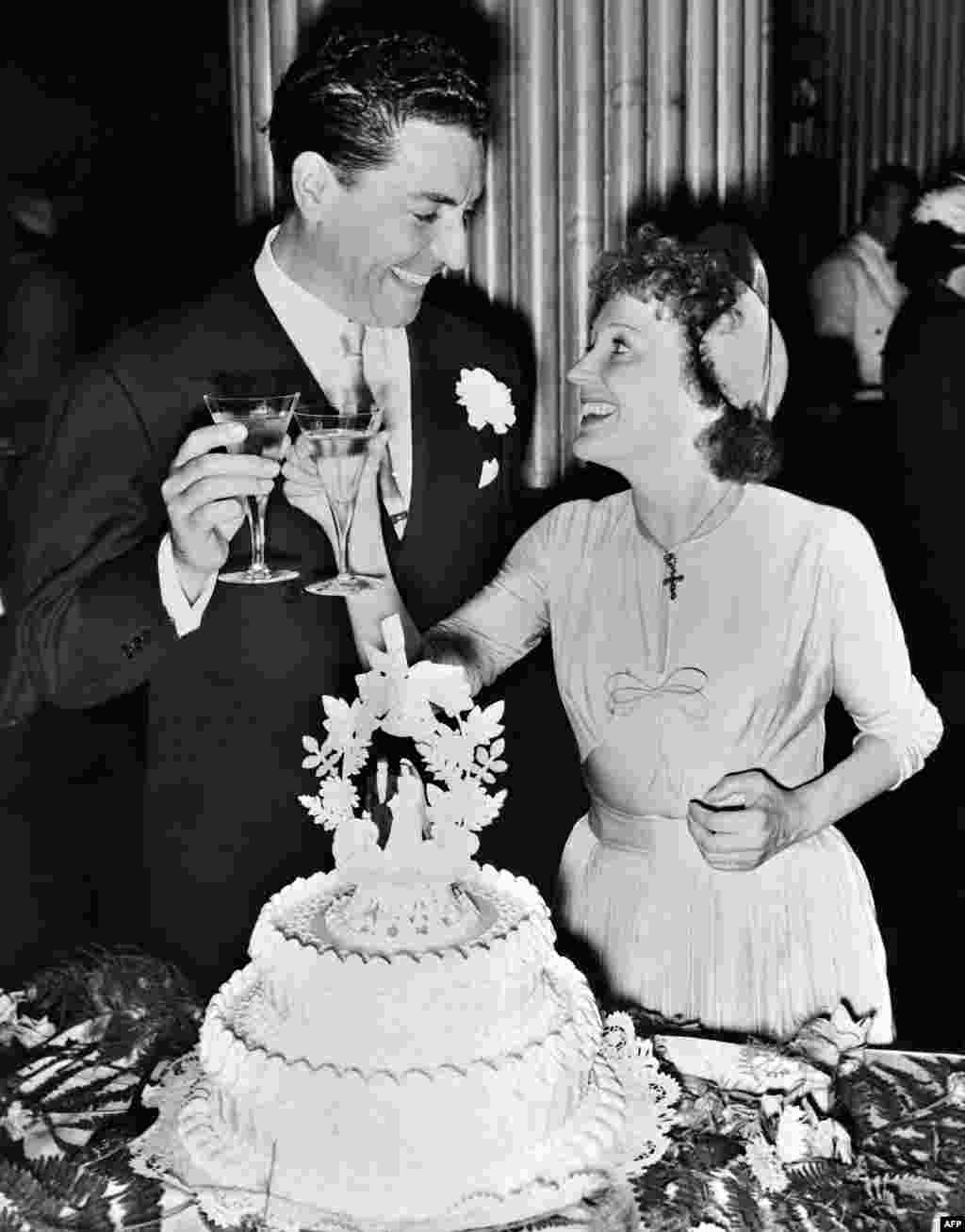 Piaf and Jacques Pills toasting at their wedding in New York on July 29, 1952.