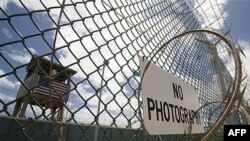 An outer fence and guard tower at the prison camp at Guantanamo Bay
