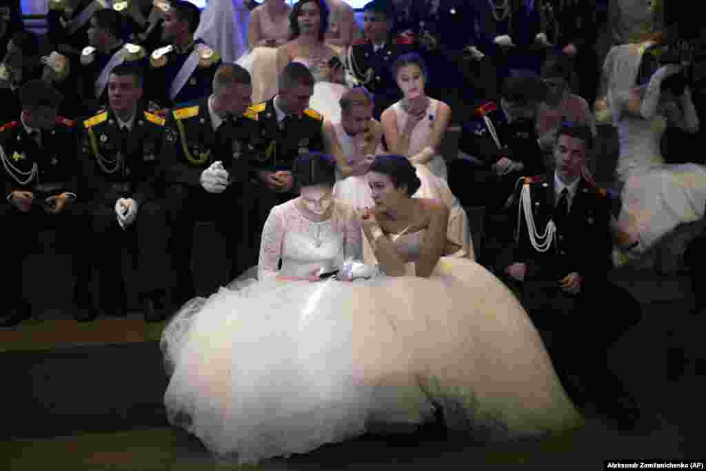 Students of military schools rest after dancing during an annual ball in Moscow. More than 1,000 students from military schools traveled from all over Russia to Moscow to take part in the ball. (AP/Alexander Zemlianichenko)