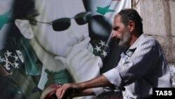 Плакат с изображением Башара Асада в Дамаске