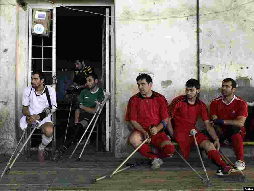 Players from football club Laman Az -- formed by landmine victims with the assistance of the local NGO Laman Az -- look on during a practice match in the Chechen capital, Grozny. (Photo for Reuters by Diana Markosian)