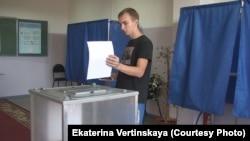 Голосование на одном из избирательных участков Иркутска, 13 сентября 2015 г.