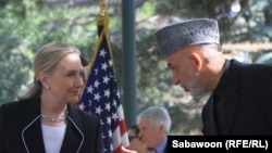 U.S. Secretary of State Hillary Clinton (left) speaks as Afghan President Hamid Karzai listens during a press conference at the presidential palace in Kabul on July 7.