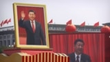 CHINA -- Participants cheer beneath a large portrait of Chinese President Xi Jinping during a parade to commemorate the 70th anniversary of the founding of Communist China in Beijing, October 1, 2019