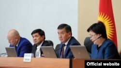 Kyrgyz Prime Minister Sooronbai Jeenbekov, second from right, and members of the government.