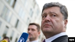 Ukrainian presidential frontrunner Petro Poroshenko gives a statement to the media earlier this month. A new report has given qualified approval to the press's coverage of the presidential election campaign.