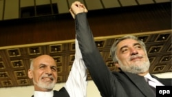 Many questions remain over how the power-sharing deal between President-elect Ashraf Ghani (left) and Abdullah Abdullah will function in practice.