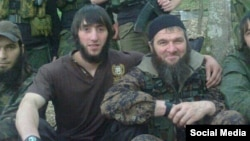"Veteran Chechen militant ""Yahya"" (left) poses with Caucasusu Emirate leader Doku Umarov."