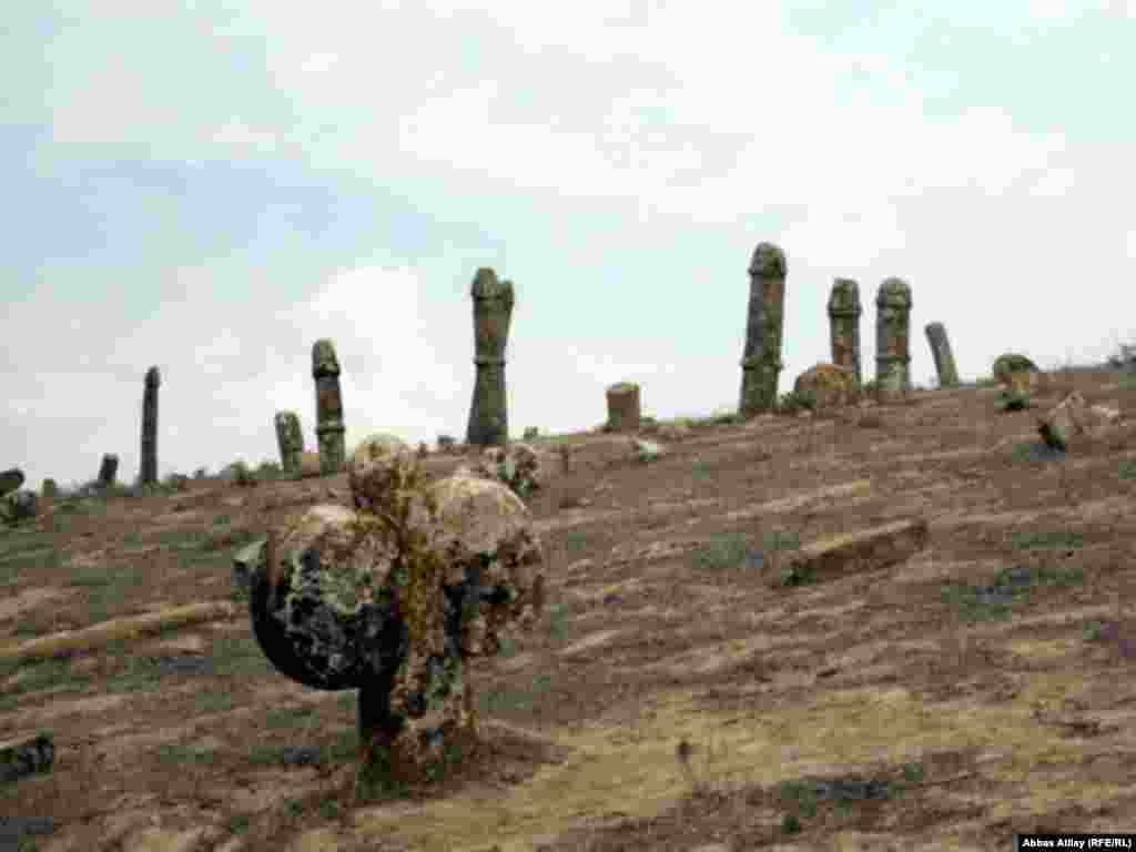 In recent years, this ancient monument has begun to deteriorate. A photograph taken just a few years earlier shows many more gravestones, including what is believed to be a female symbol, representing ovaries.
