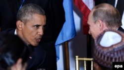 U.S. President Barack Obama (left) talks with his Russian counterpart Vladimir Putin at a luncheon during the UN General Assembly in New York on September 28.