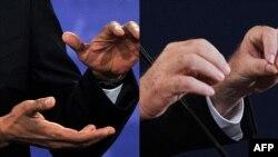 Руки участников предвыборных теледебатов: Барака Обамы и Митта Ромни