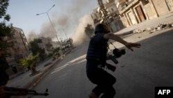 Эпизод боёв в Алеппо. Снимок сделан 24 августа 2012 г.