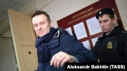 Aleksei Navalny is escorted to a court in Kirov on January 31.
