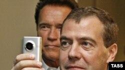 California Governor Arnold Schwarzenegger (rear) with visiting Russian President Dmitry Medvedev in June