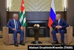 Russian President Vladimir Putin (right) meets Abkhaz leader Raul Khajimba in Sochi in August 2019