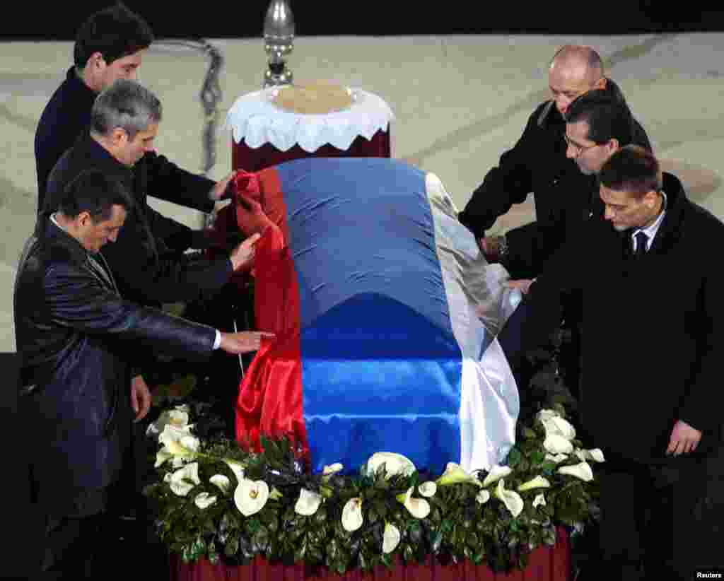 On March 12, 2003, a sniper connected to an ultranationalist police unit shot Djindjic in broad daylight outside a government building. Here, close friends and colleagues pay their last respects at the St. Sava church in Belgrade on March 15.