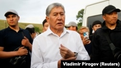Almazbek Atambaev and supporters attend a meeting with journalists in the village of Koy-Tash near Bishkek on June 27.