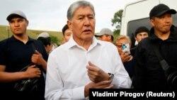Almazbek Atambaev meets with journalists outside his compound in the village of Koi-Tash near Bishkek on June 27, 2019.