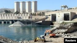 Employees work at strengthening the Mosul dam in northern Iraq on February 3.