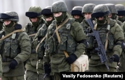 """Despite clear indications that Moscow had dispatched these """"little green men,"""" as they came to be widely known, Russia embarked on a campaign of denials and obfuscations about their provenance and role in helping cement Moscow's annexation of Crimea."""