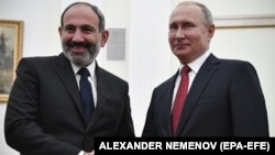 RUSSIA -- Russian President Vladimir Putin (Right) shakes hands with Armenian Prime Minister Nikol Pashinian (Left) during their meeting in the Kremlin in Moscow, Russia, 27 December 2018