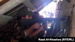Рамади шаҳри учун курашаётган Ироқ армияси ҳарбийси.