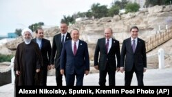 File - (R-L) Presidents of Turkmenistan, Russia, Kazakhstan, Azerbaijan and Iran meeting to discuss their respective rights in the Caspian Sea. August 12, 2018.