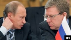 Prime Minister Vladimir Putin and former Finance Minister Aleksei Kudrin, who resigned in late September after a spat with President Dmitry Medvedev.