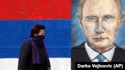 Graffiti depicting Russian President Vladimir Putin in a suburb of Belgrade (file photo)