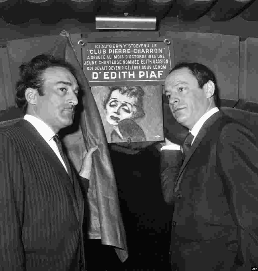 "Michel Rivegauche and Charles Dumont, former lyricists and composers for Piaf, unveil a plaque in memory of the singer on February 8, 1966 at a Paris club -- the former cabaret Le Gerny's -- where an unknown singer named Edith Gassion debuted in 1935 and quickly became famous under the name ""Mome Piaf."""